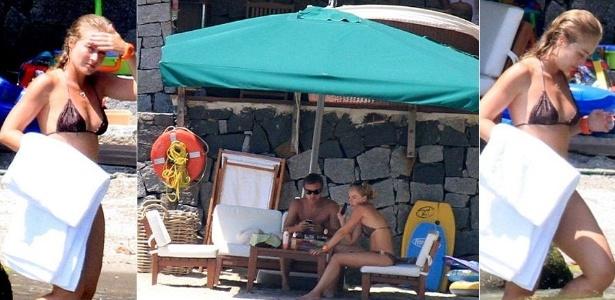 Ao lado de Luciano Huck, Angélica aproveita para tomar banho de mar em casa em Angra dos Reis, no Rio (1/2/11). O apresentador foi multado em julho, em R$ 40 mil, por cercar a residência com boias. Segundo ele, a cerca foi posta com o intuito de iniciar uma 'maricultura' (5/7/11).