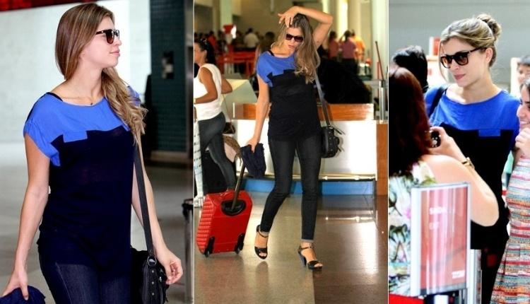Grazi Massafera exibe a barriguinha de quatro meses de gestação no aeroporto Santos Dumont, no Rio de Janeiro. A atriz tirou fotos com fãs antes de embarcar para São Paulo nesta segunda-feira (16/1/12)