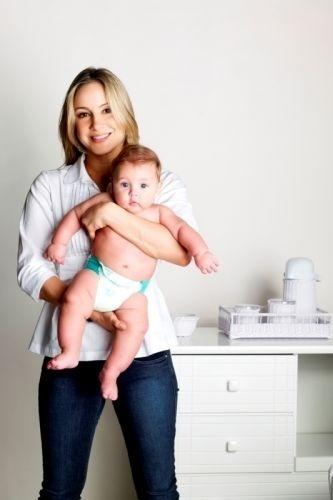 Claudia posa com o filho Davi na campanha do Aleitamento Materno (2009)