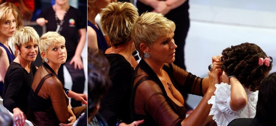 Ao lado de Ana Maria Braga, Xuxa ajuda a pequena Maysa a arrumar o vestido no programa especial de aniversário da Hebe (8/3/10)