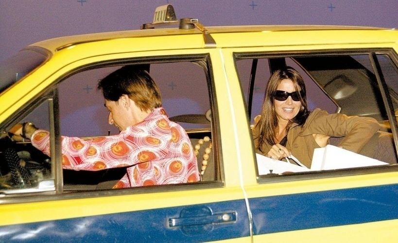"""Malu Mader gravou uma participação como ela mesma em """"A Grande Família"""", onde pegou um táxi com Agostinho, personagem de Pedro Cardoso (2004)"""