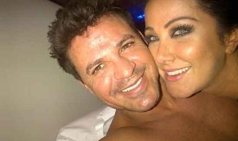 """Helen Ganzarolli, 33, não deixou barato as acusações da ex de seu namorado, o cantor sertanejo Eduardo Costa. A assistente de palco do SBT publicou no Twitter uma foto na cama e escreveu na legenda: """"Com meu amor lindo vendo filme""""."""