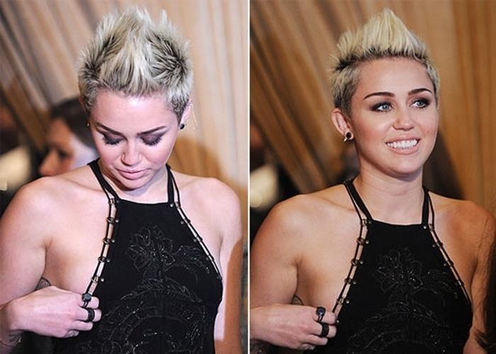 10.fev.2013 - Em uma fase ousada nas escolhas do figurino, Miley Cyrus, 20, foi traída decote durante passagem pelo tapete vermelho neste sábado (9). A cantora compareceu à festa pré-Grammy, em Los Angeles, nos Estados Unidos, com um longo preto transparente Emilio Pucci e botas de cano altíssimos Versace. Em certo momento, o decote mostrou demais. A cantora ainda tentou puxar o vestido para o lugar