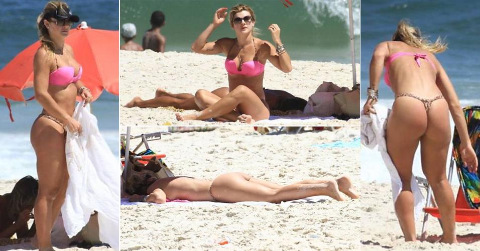 Quinta-feira (1/3) - Mirella Santos aproveita dia de sol na praia do Pepê, no Rio de Janeiro, com direito á bronze e topless na areia (1/3/12)