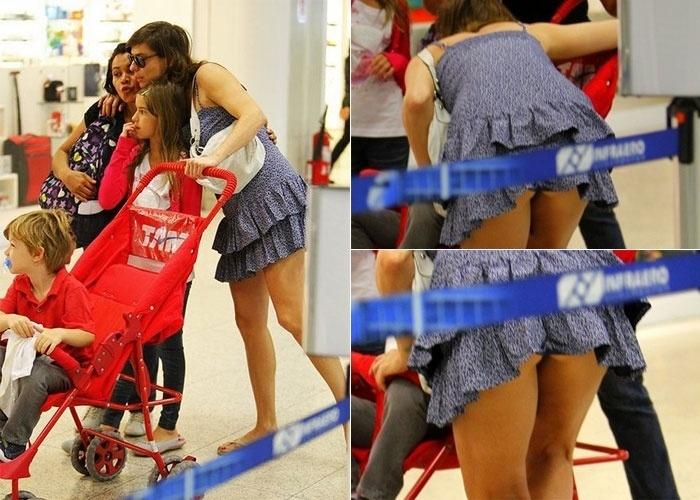 Maria Paula foi clicada em um momento indiscreto no aeroporto Santos Dumont, no Rio de Janeiro (12/7/12). Acompanhada dos filhos Maria Luiza e Felipe, a atriz, que usava um vestido curto, se abaixou e deixou aparecer a calcinha. Os paparazzi de plantão, claro, registraram o fato