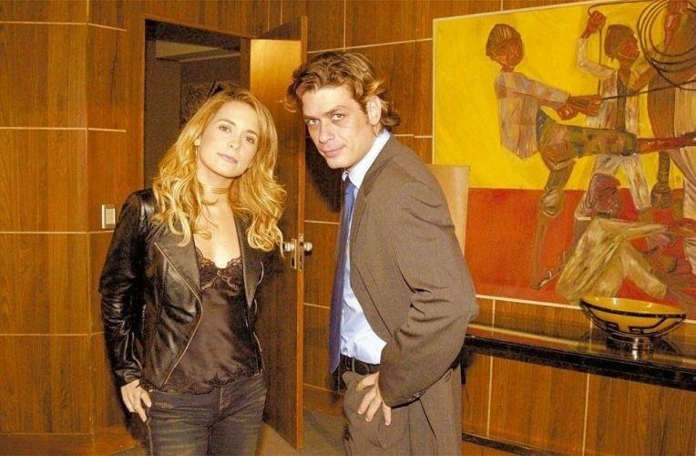 Em 2004, o ator interpretou um de seus papéis mais marcantes, o vilão Renato Mendes da novela 'Celebridade'. Na foto ele contracena com a atriz Cláudia Abreu.