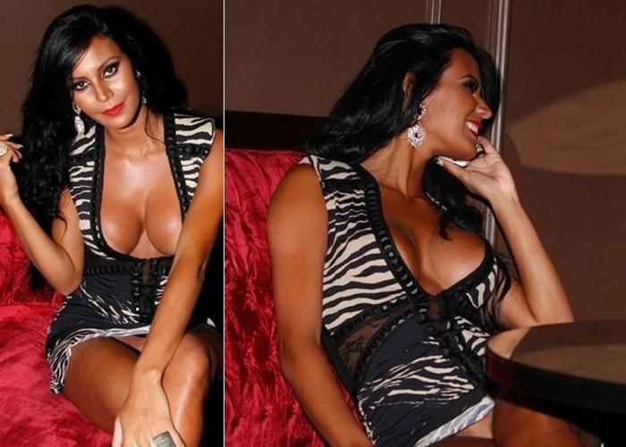 """e vestido curto e super decotado, a Gata do Paulistão Lorena Bueri foi fotografada em ângulos que quase deixaram suas parte íntimas à mostra durante a festa de 20 anos da revista """"Sexy"""" realizada em uma boate em São Paulo (7/11/12)"""