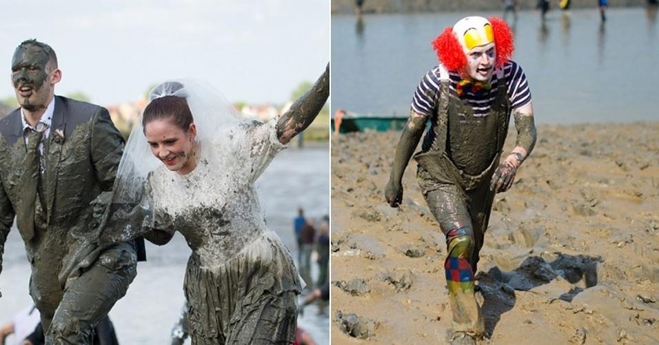"""5.mai.2013 - A """"Maldon Mud Race"""" - corrida na lama em Maldon (Inglaterra) -, que acontece desde 1973, reuniu competidores às margens do rio Blackwater. Os participantes ousaram nas fantasias para a divertida brincadeira, que tem o objetivo arrecadar dinheiro para instituições de caridade. Na imagem, uma noiva e um palhaço se aventuram na lama"""