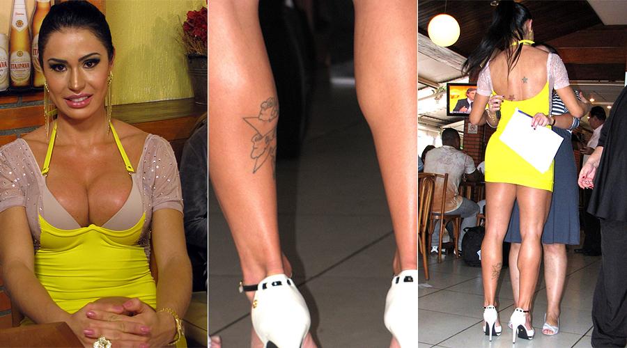 A modelo Gracyanne Barbosa tem um desenho que parece ser uma flor, na batata da perna esquerda, e estrelas coloridas nas costas. Os desenhos foram clicados em flagra da modelo no Rio de Janeiro (3/8/2011)
